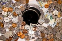唐` t在流失下的投掷金钱! 库存照片