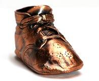 唯一婴孩古铜色的鞋子 库存照片