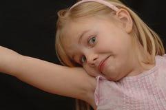 唯一逗人喜爱的表达式的女孩 免版税库存图片