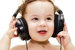 唱佩带的婴孩耳机 库存图片