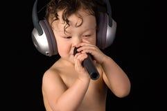 唱婴孩。 图库摄影