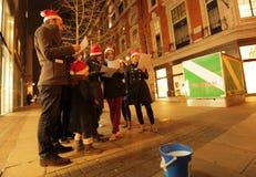 唱歌圣诞节颂歌 免版税库存图片