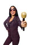 唱歌在卡拉OK演唱俱乐部的妇女隔绝在whie 免版税库存图片