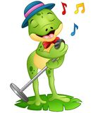 唱歌在叶子的动画片青蛙 免版税库存照片