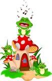 唱歌在蘑菇的动画片3青蛙 免版税库存图片