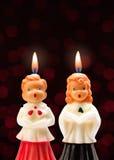 唱诗班男孩和女孩蜡烛 免版税库存图片