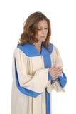 唱诗班祈祷的长袍妇女 免版税库存图片