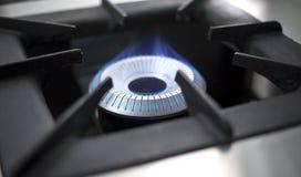 商业厨房煤气喷燃器火焰 库存照片