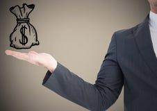 商人与实施和金钱乱画反对棕色背景 免版税库存图片