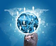 商人举行地球在手中 世界地图与 免版税图库摄影