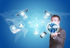 商人举行地球地球和电子 免版税库存图片