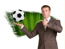 商人举行足球在手中 库存照片