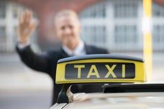 商人传染性的出租汽车 免版税库存照片