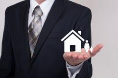商人保护的家庭保险概念 免版税库存图片