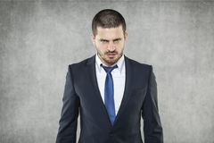 商人做了一张恼怒的面孔 免版税库存照片