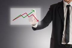 商人分析在触摸屏上的储蓄图表,成功的概念 免版税库存图片