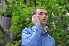 商人发表演讲关于手机 图库摄影
