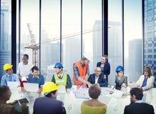 商人合作会议介绍建筑师设计 免版税库存照片