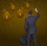 商人和袋子金钱 免版税库存图片