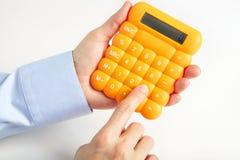 商人和黄色计算器 免版税库存照片