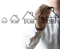 商人图画房子 免版税图库摄影