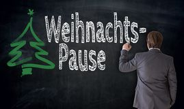 商人在德国圣诞节断裂o写Weihnachtspause 库存照片