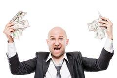 商人在拿着美元货币金钱的黑衣服手上 免版税库存照片