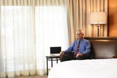 商人在旅馆客房 免版税图库摄影
