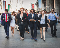 商人在米兰,意大利立刻参与暴民 库存照片