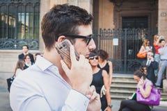 商人在米兰,意大利立刻参与暴民 库存图片