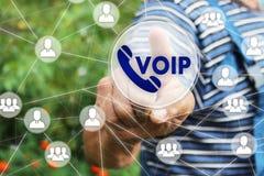 商人在触摸屏点击按钮VOIP 免版税库存图片