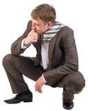 商人坐他的腰臀部分 免版税库存图片