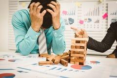 商人头疼和重音,失业的概念 免版税库存照片