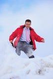 商人室外随风飘飞的雪 免版税图库摄影