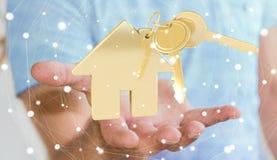 商人对负关键与房子钥匙圈在他的手3D上回报 免版税图库摄影