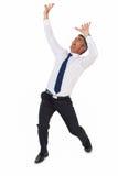商人尖叫与胳膊 免版税库存图片