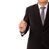 商人常设姿势手举行在白色w隔绝的笔 免版税库存照片
