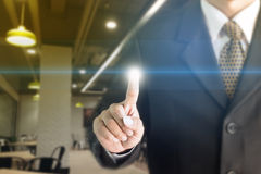 商人常设手触摸屏 您能增加文本到您的广告 免版税库存图片