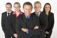 商人微笑的小组 免版税库存照片