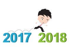 商人愉快对跑从2017年到2018年,新年成功概念,提出以形式 免版税图库摄影