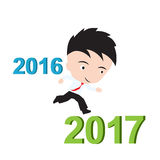 商人愉快对跑从2016年到2017年,新年成功概念,提出以形式 免版税图库摄影