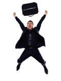 商人愉快的快乐的跳跃的剪影 库存照片