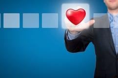 商人感人的心脏按钮和滴答作响的复选框 免版税库存照片