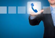 商人感人的电话按钮和滴答作响的复选框 免版税库存图片