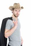 商人或年轻人佩带的牛仔帽和黑夹克 库存照片