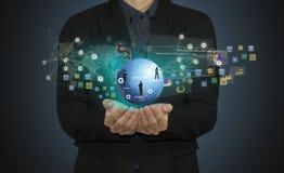 商人手与现代计算机和企业象一起使用 免版税库存图片