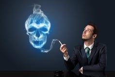 商人抽烟 库存图片
