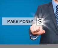商人按在虚屏做金钱按钮 免版税库存图片