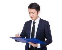 商人摘记关于剪贴板的笔记 免版税库存照片