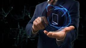 商人显示概念在他的手上的全息图3d电视 股票录像